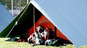 Big tent of boy scout camp and the rucksack. Put out in the open air Royalty Free Stock Photo