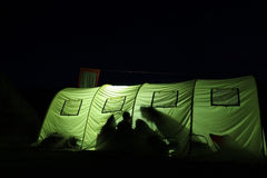 Big tent at night lightened up from inside Royalty Free Stock Photos