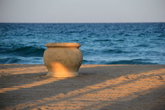 Big terra cotta pot on sandy beach Royalty Free Stock Images