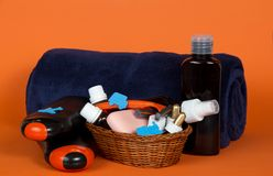 Big terry towel and basket with cosmetics Stock Image