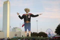 Big Tex at Fair Park sunset. People walk around Big Tex on Fair Park sunset, State Fair of Texas city Dallas USA Stock Photo