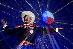 Big Tex and  Ferris  Wheel at night Stock Photos