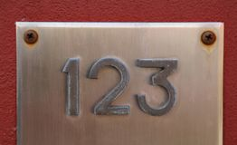 Big Text with number 123 on the wall. Big Text with number 123 in steel on the wall royalty free stock photo