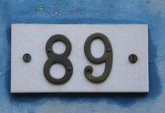 Big Text with number 89 on the wall. Of an house royalty free stock photos