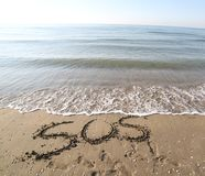 Big text SOS on the sand of the beach. In summer Royalty Free Stock Images