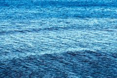 The big textured water surface of blue color Stock Image