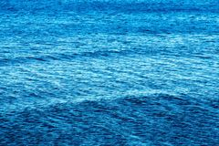The big textured water surface of bright blue color Stock Photo