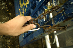 Big thick chain lock on a black metal gate Royalty Free Stock Photo