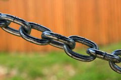 Big thick steel dark metal chain links foreground closeup outside royalty free stock photo