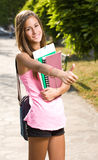 Big thumbs up by beautiful teen student. Royalty Free Stock Image