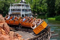 Free Big Thunder Mountain Railroad And Liberty Square River Boat In Magic Kingdom At Walt Disney World  2 Royalty Free Stock Photography - 150805237