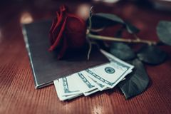 Big Tips under passbook and Rose on Table stock images