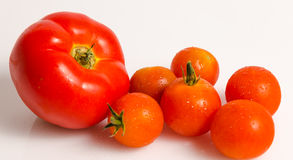 Big tomato and small cherry Royalty Free Stock Photography