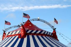 The big top. Of the American Circus with flags aloft and blowing in the breeze Stock Photo