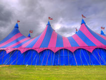 Big top circus tent on a field. With brooding sky Stock Image