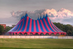 Big top festival tent in red blue green. Big top circus tent on grass in the park Royalty Free Stock Images