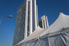 Big top and modern buildings Royalty Free Stock Photos