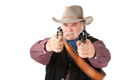 Big, Tough Cowboy. With leather holster pointing two pistols Stock Image
