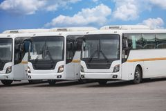 Tourist buses on parking. Big tourist buses on parking Royalty Free Stock Image