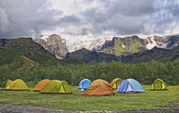Big tourist camp is located in the valley of the park near the glacier Royalty Free Stock Photo