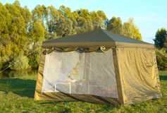 A big tourist tent on the Bank of the river. Stock Photography