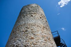 Big tower of a medieval castle facing the sky Royalty Free Stock Photography
