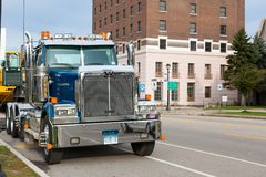 Big towing truck in Buffalo in USA in the street. Frontal view stock photos