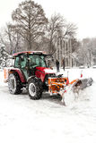 A big tractor removal snow in park Royalty Free Stock Photography