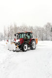 A big tractor removal snow in park Stock Photos
