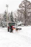 A big tractor removal snow in park after storm Stock Image