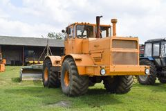 The Big tractor. Russia, Temryuk - 15 July 2015: Big tractor. Old Soviet agricultural machinery Stock Image