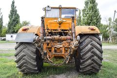 The Big tractor. Russia, Temryuk - 15 July 2015: Big tractor. Old Soviet agricultural machinery Stock Images