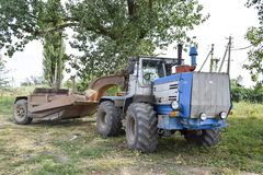 The Big tractor. Russia, Temryuk - 15 July 2015: Big tractor. Old Soviet agricultural machinery Royalty Free Stock Photography