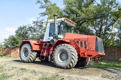 The Big tractor. Russia, Temryuk - 15 July 2015: Big tractor. Old Soviet agricultural machinery Royalty Free Stock Photo