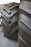 Big tractor tires - rubber wheels for agricultural tractor. Close up Royalty Free Stock Images