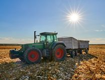 Tractor with trailers at harvest. Big tractor with two trailers at corn harvest Royalty Free Stock Photos