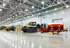 Big tractors are in room at exhibition Royalty Free Stock Photo