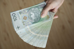Big transaction. Hand full of money over the desk Royalty Free Stock Photo