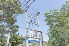 Big transformer installed on the pole. With electrical wiring and sky background stock photos