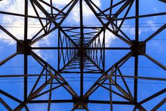 Big transmission tower high voltage power line, bottom view. Hazard concept, hazardous work, electric. Big transmission tower of high voltage power line, bottom stock images