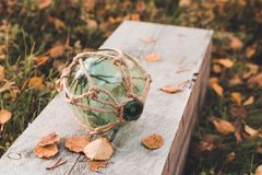 Big transparent glass sphere lies in a wooden board stock photography