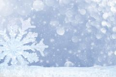 Big transparent snowflake in snow and beautiful bokeh with asterisks and snowfall. Stock Photography
