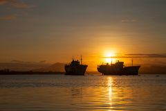Big transport boats in the morning sunrise. stock photography