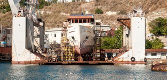 Big transport ship standing in docks Stock Photo