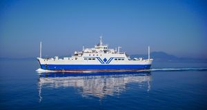 Big transportation ferryboat sailing in blue calm water Stock Photo