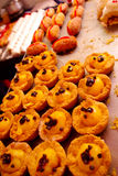 Big tray with different desserts, little hampers filled up and little sweet hotdogs Stock Image