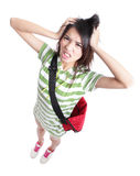 Big trouble - Young Teenage girl student. Pulling her hair in full length isolated on white background, from high angle view, model is a asian woman Stock Images