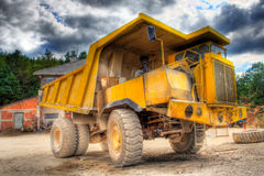 Big truck at construction yard. HDR picture Royalty Free Stock Photo