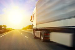 Truck goes on the highway. Big truck goes on the highway to sunrise Royalty Free Stock Photos