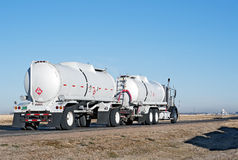 Big truck hauling crude oil. Semi-truck and trailer combination known as a double bottom hauling crude oil Royalty Free Stock Photo
